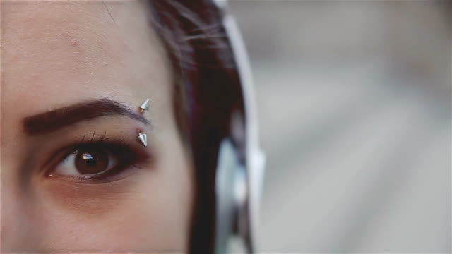 Eyebrow piercing,close up