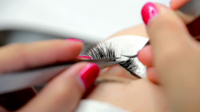eyelash extension close-up - beautician stock videos and b-roll footage