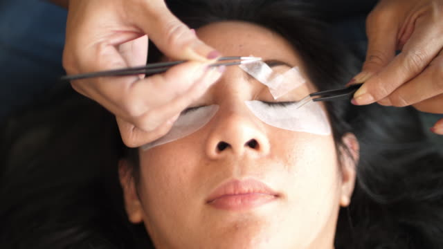 eyelash extension procedure - beauty spa stock videos & royalty-free footage