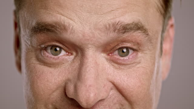 eyes of a caucasian man making gestures - raised eyebrows stock videos & royalty-free footage