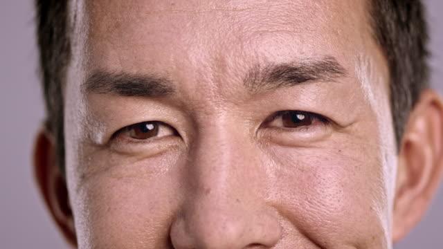 eyes of a flirty asian man - raised eyebrows stock videos & royalty-free footage