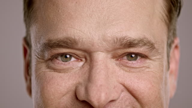 eyes of a middle-aged man smiling - front view stock videos & royalty-free footage