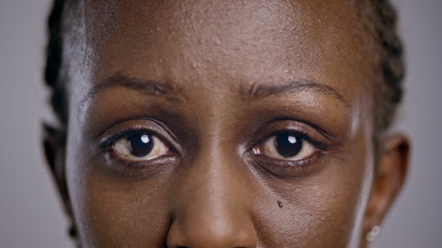 eyes of a sad african-american woman - staring stock videos & royalty-free footage