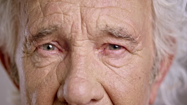eyes of a sad senior caucasian man - staring stock videos & royalty-free footage