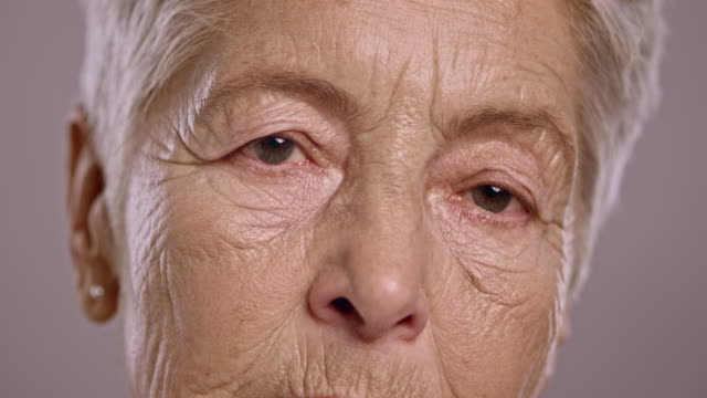 eyes of a sad senior caucasian woman - senior women stock videos & royalty-free footage