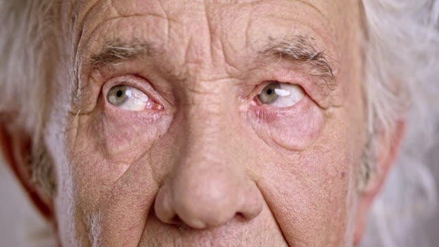 Eyes of a senior Caucasian man looking around