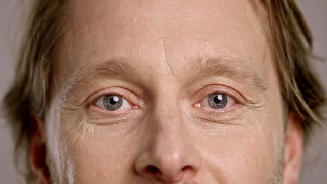eyes of a smiling caucasian man - eye stock videos & royalty-free footage