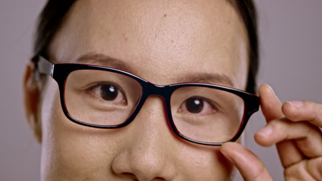 Eyes of a young Asian woman wearing glasses