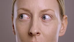 Eyes of a young Caucasian woman looking around