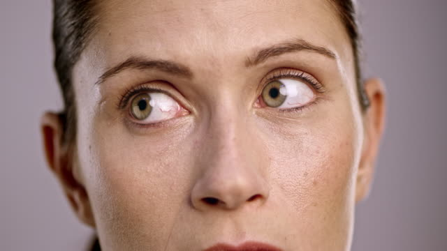 eyes of a young caucasian woman looking around - looking around stock videos & royalty-free footage