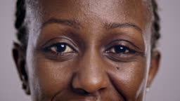 Eyes of an African-American woman blinking