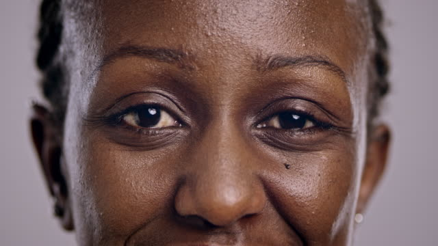eyes of an african-american woman blinking - eyelid stock videos & royalty-free footage