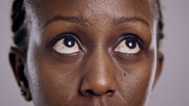 eyes of an african-american woman looking around - confusion stock videos & royalty-free footage