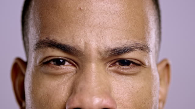 eyes of an angry young african-american man - anger stock videos & royalty-free footage