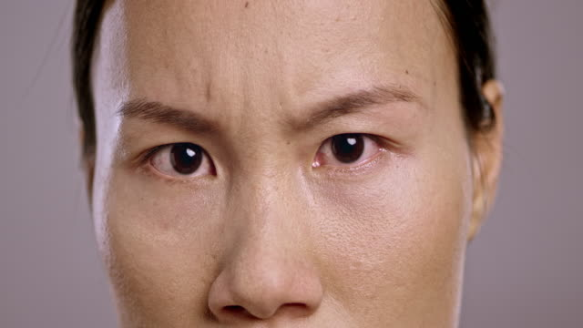 Eyes of an angry young Asian woman
