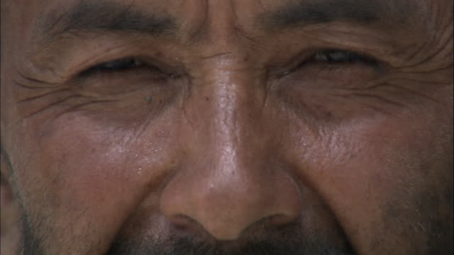 eyes of man, hetian, xinjiang province, china, - nose stock videos & royalty-free footage