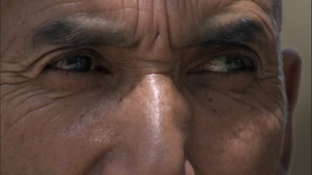 Eyes of man, Hetian, Xinjiang province, China,