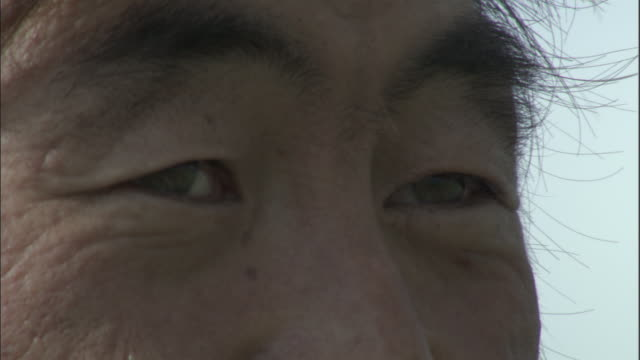 eyes of mongol man, bayanbulak grasslands. - human face stock videos & royalty-free footage