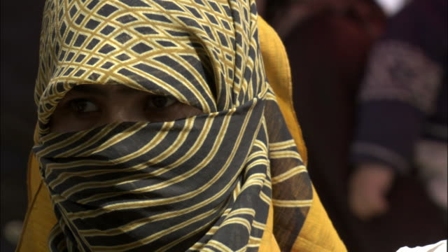 Eyes of woman with her face shrouded, Kashgar market, Hetian, Xinjiang province, China,