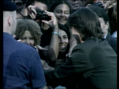 Eyes Wide Shut' premiere ITN Tom Cruise meeting fans Nicole Kidman shaking hands with fans INT Tom Cruise press conference SOT When he was writing a...