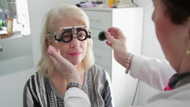 eyesight testing - lens optical instrument stock videos & royalty-free footage