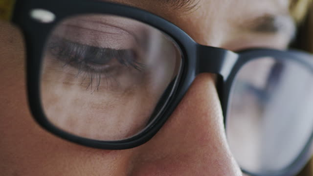 eyewear with lenses featuring digital eye strain-reducing capabilities - eyeglasses stock videos & royalty-free footage