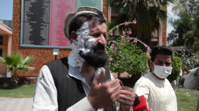 eyewitnesses describe the scene of a suicide bomb attack on a funeral in eastern afghanistan which killed at least two dozen mourners - suicide bombing stock videos & royalty-free footage