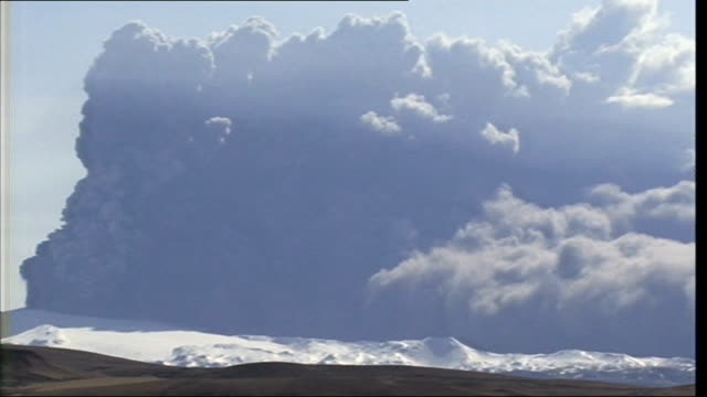 Eyjafjallajokull volcano erupting More long distance GVs of erupting volcano seen beyond barren landscape in f/g GV of erupting volcano and smoke...