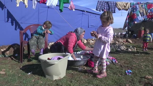 ezidis fled from the attacks of daesh shelter at the outskirts of sinjar mountains and live under harsh conditions with their families in makeshift... - resourceful stock videos & royalty-free footage