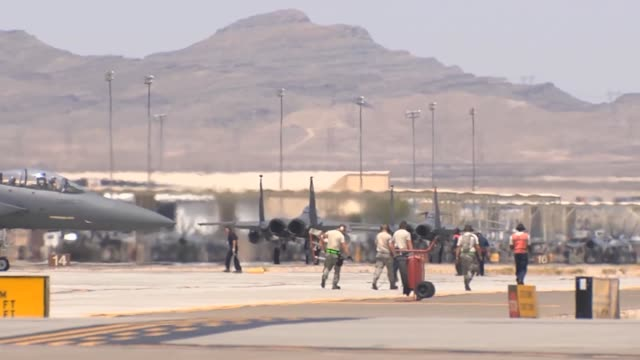 vídeos de stock, filmes e b-roll de f15es taxi out for takeoff during red flag 143 jul 18 2014 at nellis air force base nev red flag gives airmen an opportunity to experience realistic... - nellis air force base