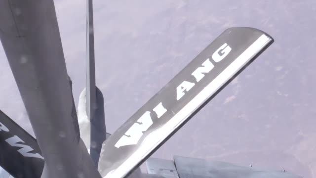 f16s assigned to the 77th expeditionary fighter squadron bagram airfield afghanistan fly as they are refueled by a kc135 stratotanker from the 340th... - bagram stock-videos und b-roll-filmmaterial