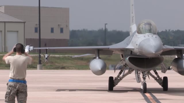 F16s taxiing around Denver International Airport with commercial airlines The Colorado Air National Guard F16s were temporarily operated at Denver...