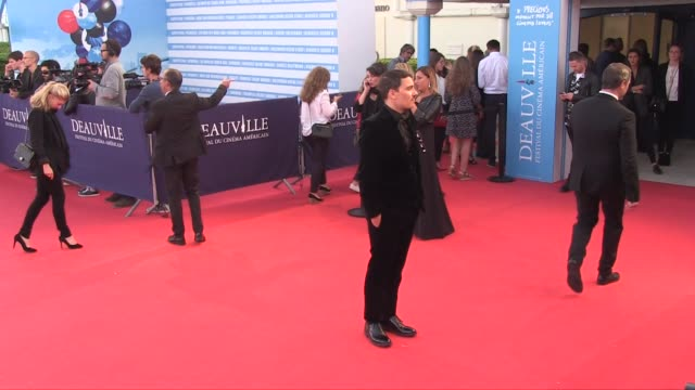 Fabien Constant and Lady Monika and Andrea Iervolino Bacardi for the Here and now red carpet during the 2018 Deauville film festival Deauville France...