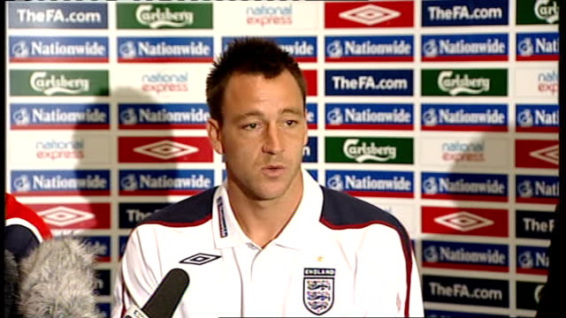 Fabio Capello and John Terry press conference ENGLAND Location Unknown INT Fabio Capello and John Terry sitting for press conference as Fabio Capello...