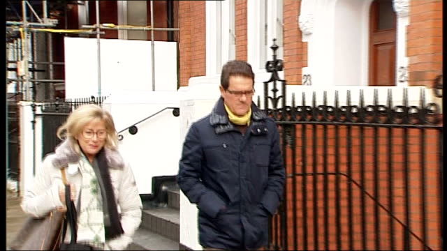 fabio capello to meet with fa over john terry captaincy row england london ext fabio capello along from his house with wife pan to back view - リチャード・パロット点の映像素材/bロール