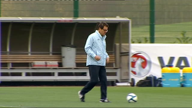 fabio capello to meet with fa over john terry captaincy row r14111102 london colney capello along on training pitch and talking to other coaches - リチャード・パロット点の映像素材/bロール