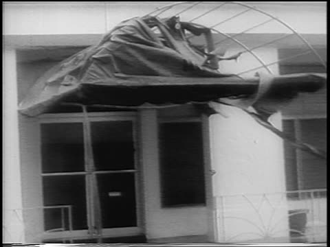 b/w 1960 fabric of awning above doorway blowing in wind during hurricane donna / florida - awning stock videos & royalty-free footage