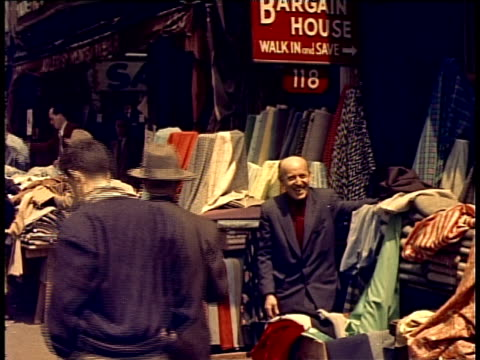 1940 WS Fabric vendors in street / New York City, New York, USA