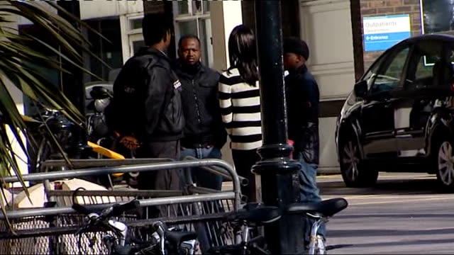 hospital arrivals england london london chest hospital ext group of unidentified people entering and leaving hospital including one man wearing... - fabrice muamba stock videos and b-roll footage