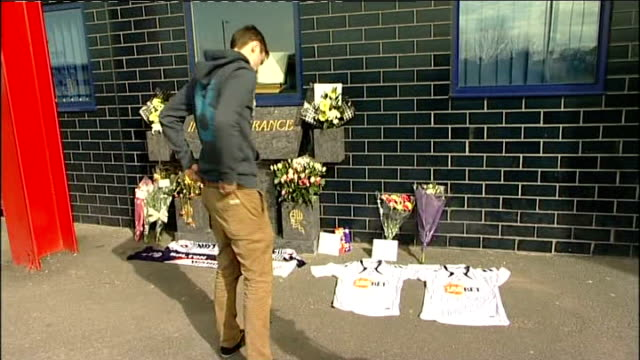 reebok stadium flowers and tributes england greater manchester bolton reebok stadium ext various shots of flowers and football shirts laid outside... - bolton greater manchester stock videos and b-roll footage