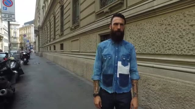 Fabrizio wearing a vintage Levis shirt Levis denim jeans and Red Wing shoes during Milan Men's Fashion Week SS17 on June 19 2016 in Milan Italy