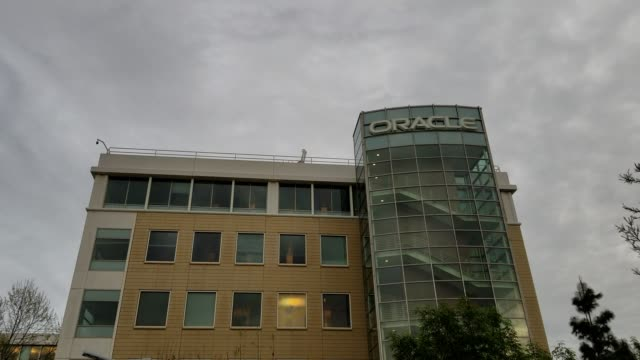 facade at regional headquarters of technology company oracle in dublin california april 9 2018 - oracle corporation stock-videos und b-roll-filmmaterial