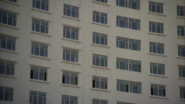 cu la facade of block of flats, dezhou, shandong, china - campo totale video stock e b–roll