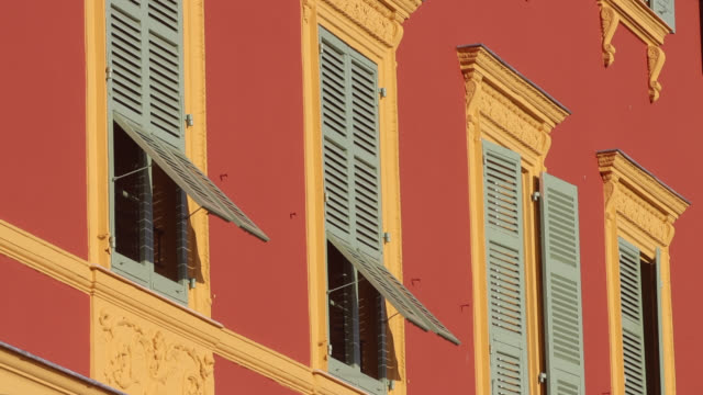 facade of colorful apartment building in nice - south stock videos & royalty-free footage