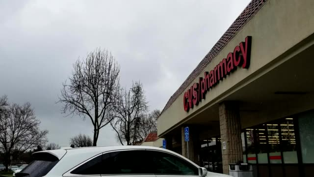 facade of cvs pharmacy on an overcast day with parked cars visible in san ramon, california, february 4, 2019. - cvs caremark stock videos & royalty-free footage
