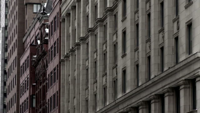 facade of downtown montreal buildings - campo totale video stock e b–roll