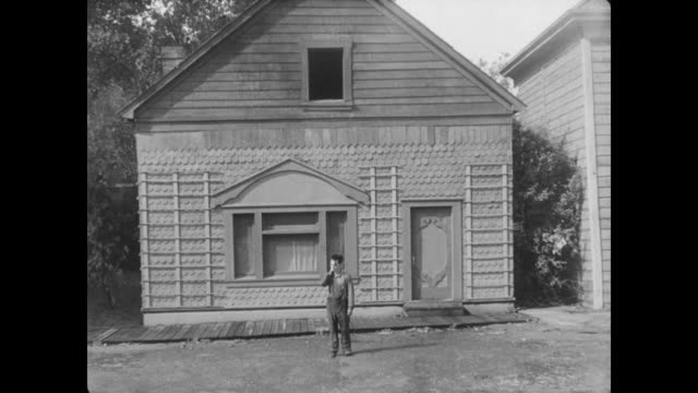 1928 facade of house falling onto man (buster keaton), who narrowly escapes being hit as he passes through window - near miss stock videos and b-roll footage