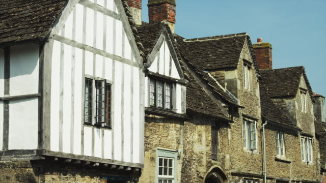 ms facade of old houses / cotswolds, wiltshire, uk - cotswolds stock videos & royalty-free footage