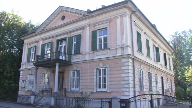 Facade of one-time villa of composer Oscar Straus, cut to plaque on wall