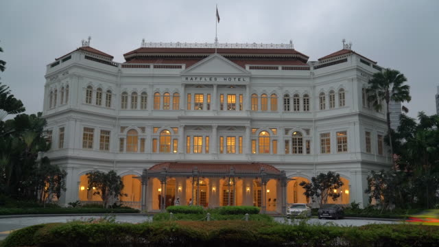 facade of raffles hotel , singapore city, central singapore, singapore, on tuesday, september 10, 2019. - raffles city stock videos & royalty-free footage